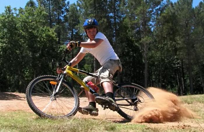 тормозить на велосипеде