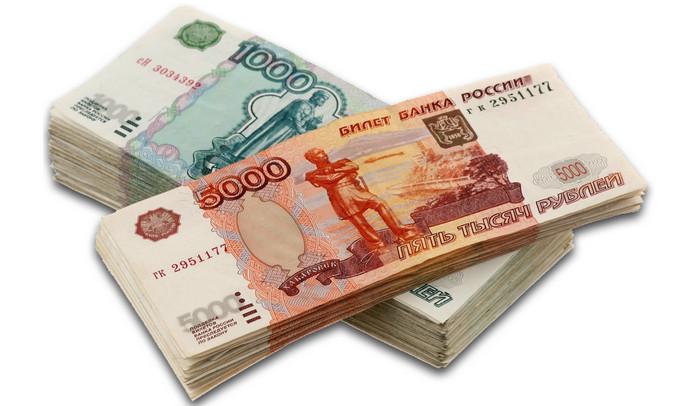 пачки денежных купюр