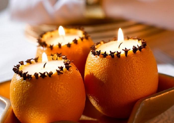 свечи в апельсинах